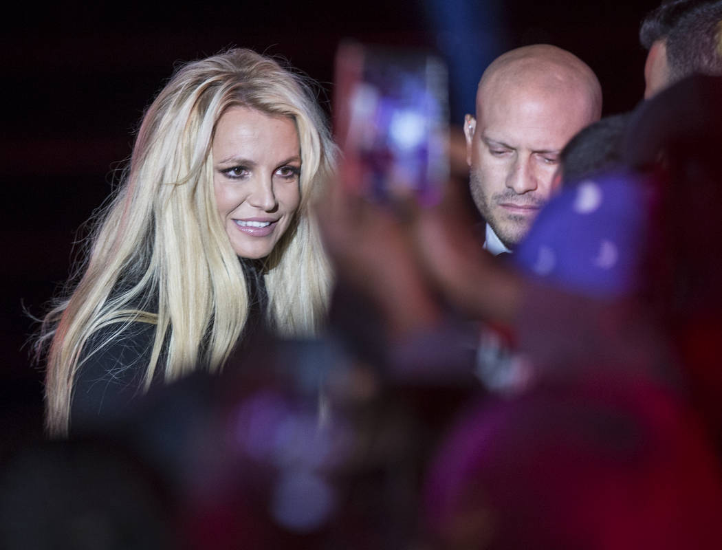 Britney Spears signs autographs during an event to announce her new residency at The Park Theater at Park MGM on Thursday, Oct. 18, 2018, outside T-Mobile Arena, in Las Vegas. (Benjamin Hager/Las ...