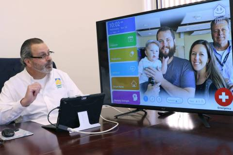 Anthony Rufo, president of HAPPIE Home, demonstrates how Happie Home, a new in-home digital companion, works at his Henderson office on Wednesday, Nov. 14, 2018. Happie Home is an in-home digital ...