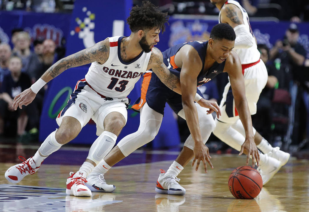 Gonzaga's Josh Perkins (13) tries to steal the ball from Pepperdine's Eric Cooper Jr. during the first half of an NCAA semifinal college basketball game at the West Coast Conference tournament, Mo ...