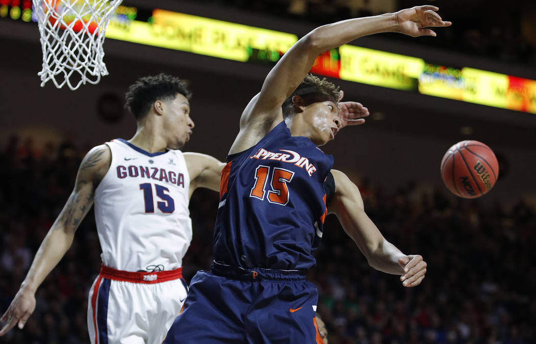 Gonzaga's Brandon Clarke, left, fouls Pepperdine's Kessler Edwards during the second half of an NCAA semifinal college basketball game at the West Coast Conference tournament, Monday, March 11, 20 ...