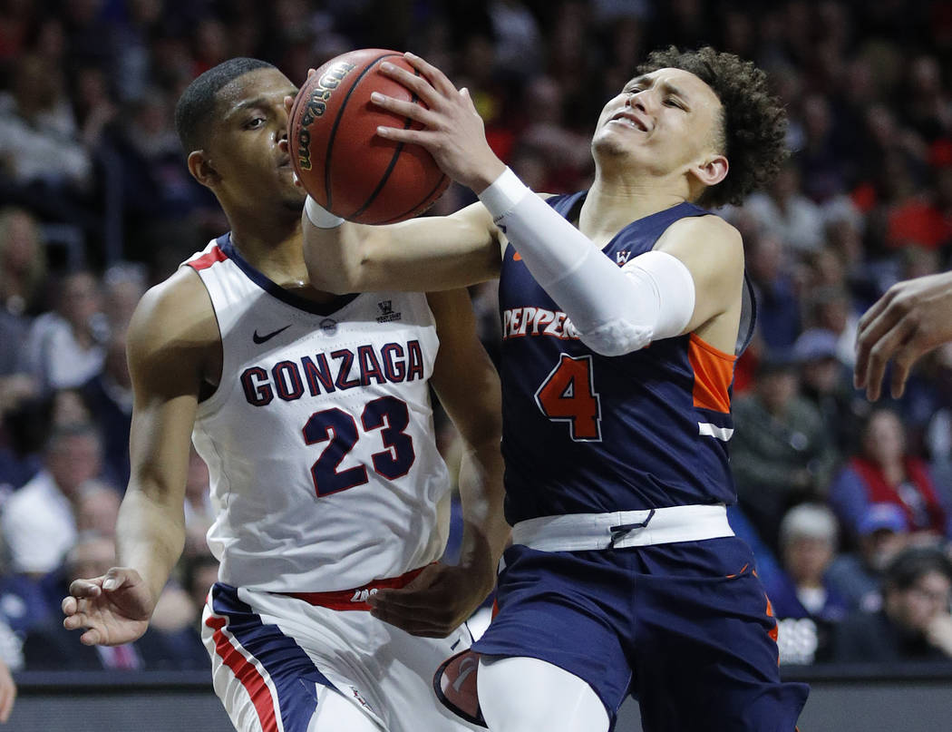 Pepperdine's Colbey Ross (4) drives around Gonzaga's Zach Norvell Jr. during the second half of an NCAA semifinal college basketball game at the West Coast Conference tournament, Monday, March 11, ...