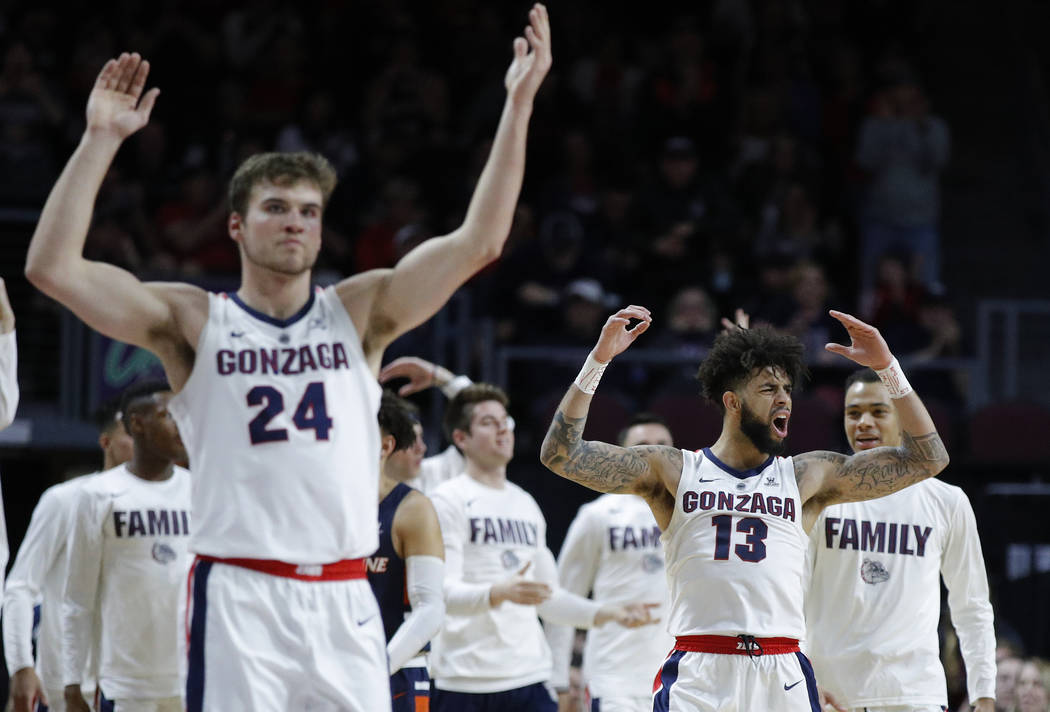 Gonzaga's Josh Perkins (13) and Corey Kispert (24) celebrate after a play against Pepperdine during the second half of an NCAA semifinal college basketball game at the West Coast Conference tourna ...