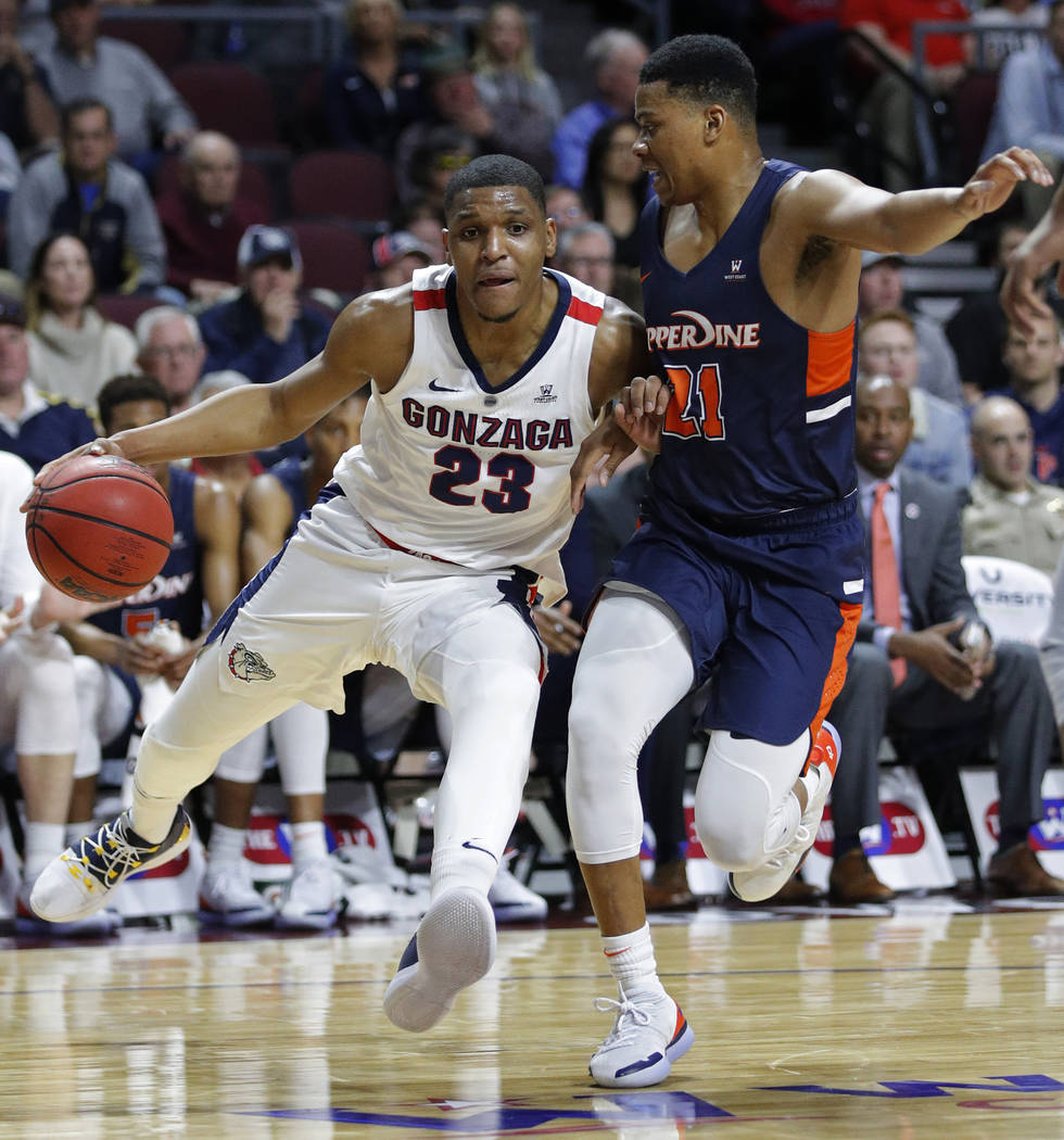 Gonzaga's Zach Norvell Jr., left, drives around Pepperdine's Eric Cooper Jr. during the first half of an NCAA semifinal college basketball game at the West Coast Conference tournament, Monday, Mar ...