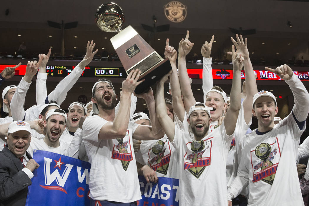 St. Mary's hoists the trophy after upsetting Gonzaga 60-47 to win the West Coast Conference championship on Tuesday, March 12, 2019, at Orleans Arena, in Las Vegas. (Benjamin Hager Review-Journal) ...