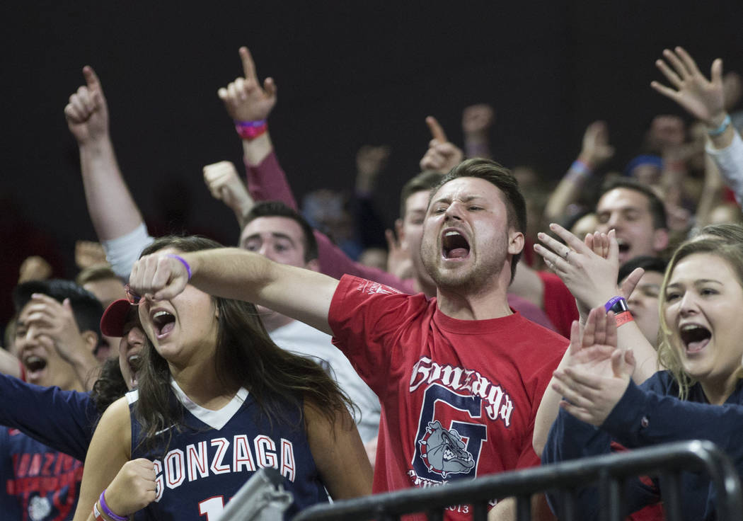 Gonzaga fans cheer for the Bulldogs in the second half during their West Coast Conference finals game with St. Mary's on Tuesday, March 12, 2019, at Orleans Arena, in Las Vegas. St. Mary's beat G ...