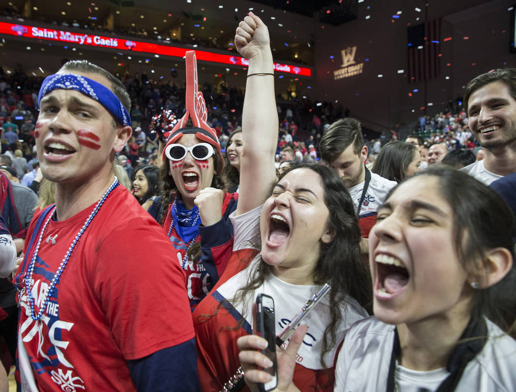 St. Mary's fans celebrates after the Gaels upset Gonzaga 60-47 to win the West Coast Conference championship on Tuesday, March 12, 2019, at Orleans Arena, in Las Vegas. (Benjamin Hager Review-Jou ...