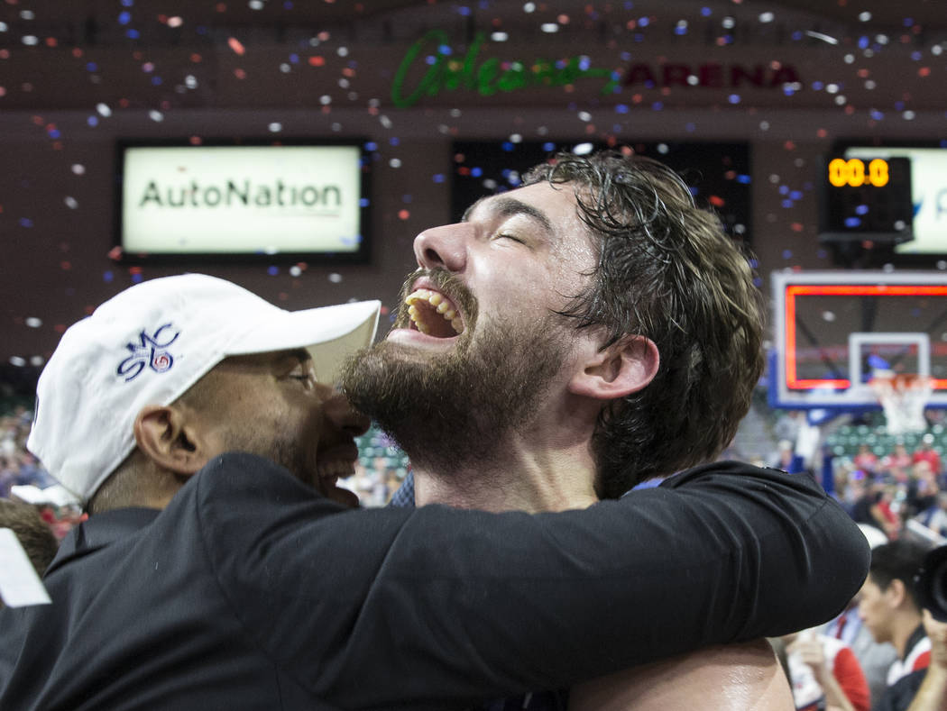 St. Mary's senior center Jordan Hunter, right, celebrates after the Gaels upset Gonzaga 60-47 to win the West Coast Conference championship on Tuesday, March 12, 2019, at Orleans Arena, in Las Veg ...