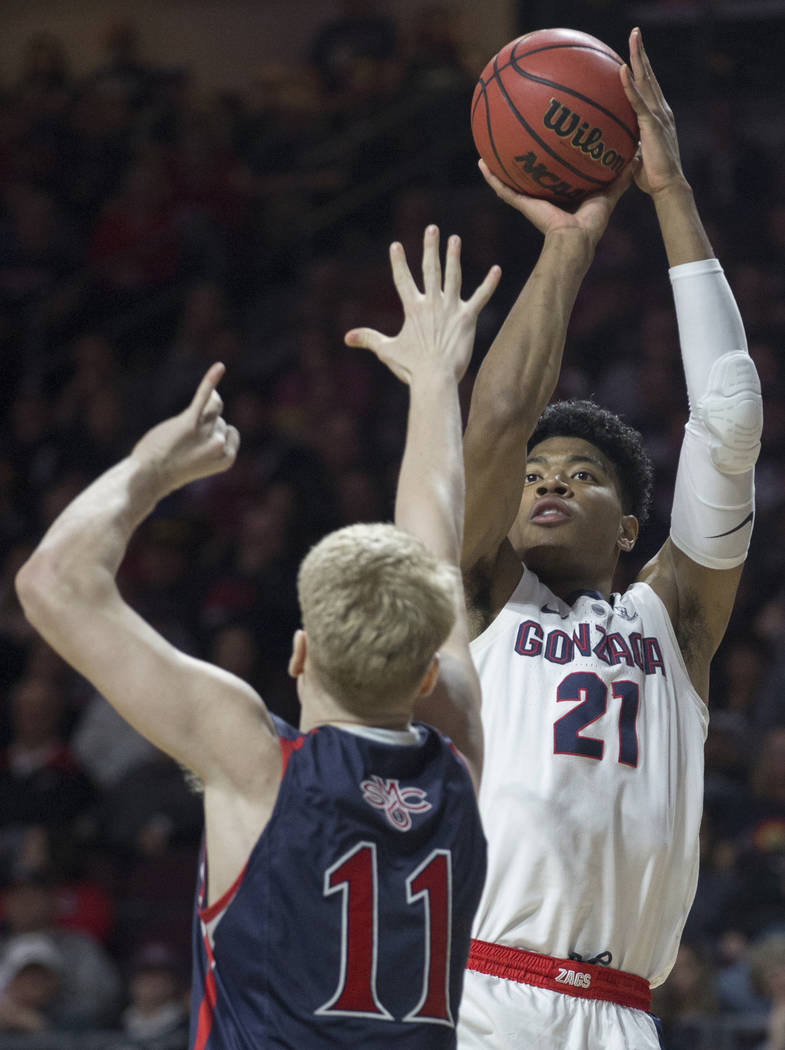 Gonzaga junior forward Rui Hachimura (21) shoots a corner three over St. Mary's freshman forward Matthias Tass (11) in the first half during the West Coast Conference finals game on Tuesday, March ...