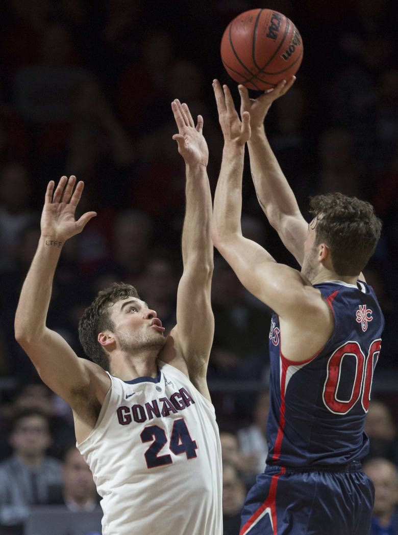 Gonzaga sophomore forward Corey Kispert (24) contests the shot of St. Mary's junior guard Tanner Krebs (00) in the first half during the West Coast Conference finals game on Tuesday, March 12, 201 ...