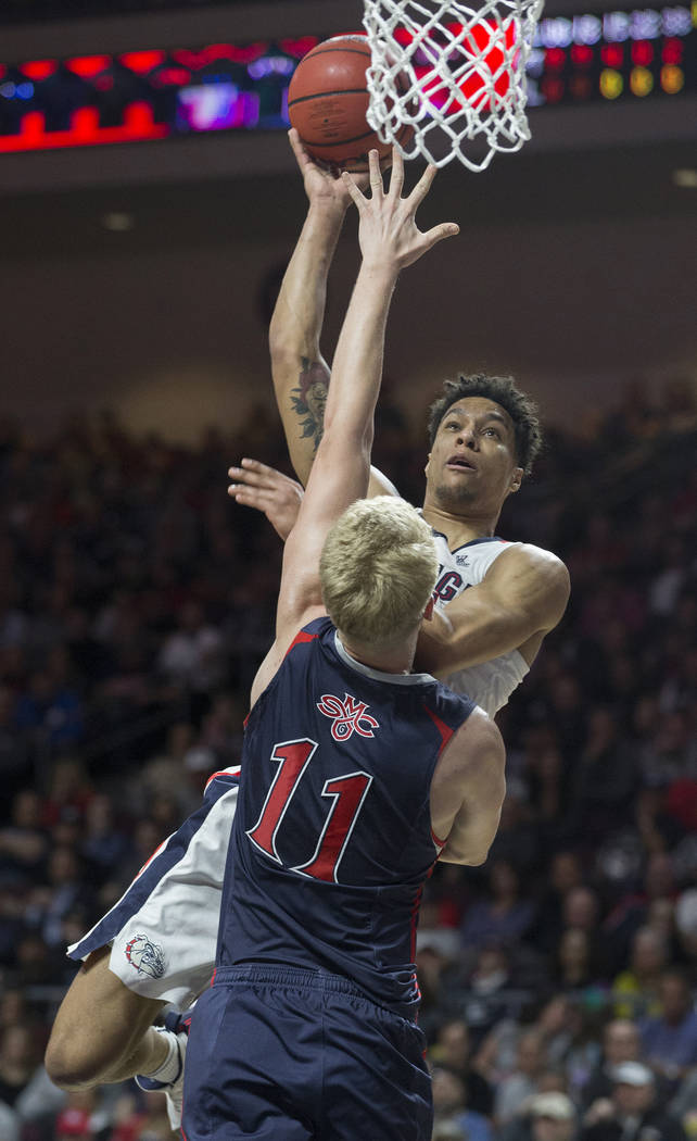 Gonzaga junior forward Brandon Clarke (15) shoots a jump shot over St. Mary's freshman forward Matthias Tass (11) in the first half during the West Coast Conference finals game on Tuesday, March 1 ...