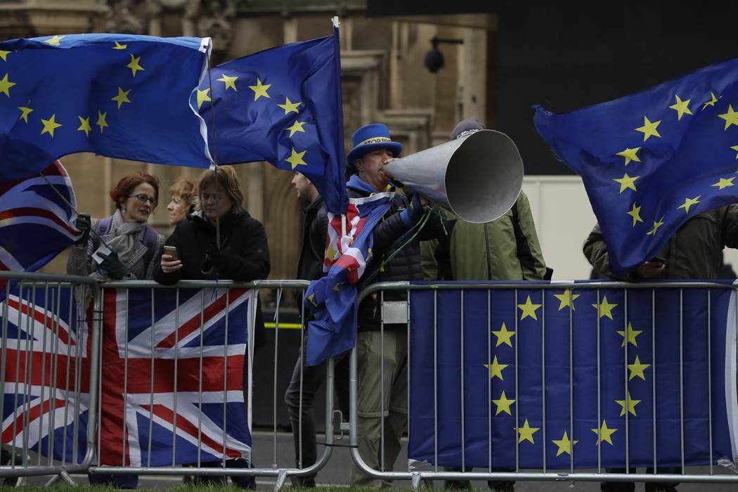 An anti-Brexit remain in the European Union supporter shouts slogans during a protest outside the Houses of Parliament in London, Tuesday, March 12, 2019. British Prime Minister Theresa May faced ...