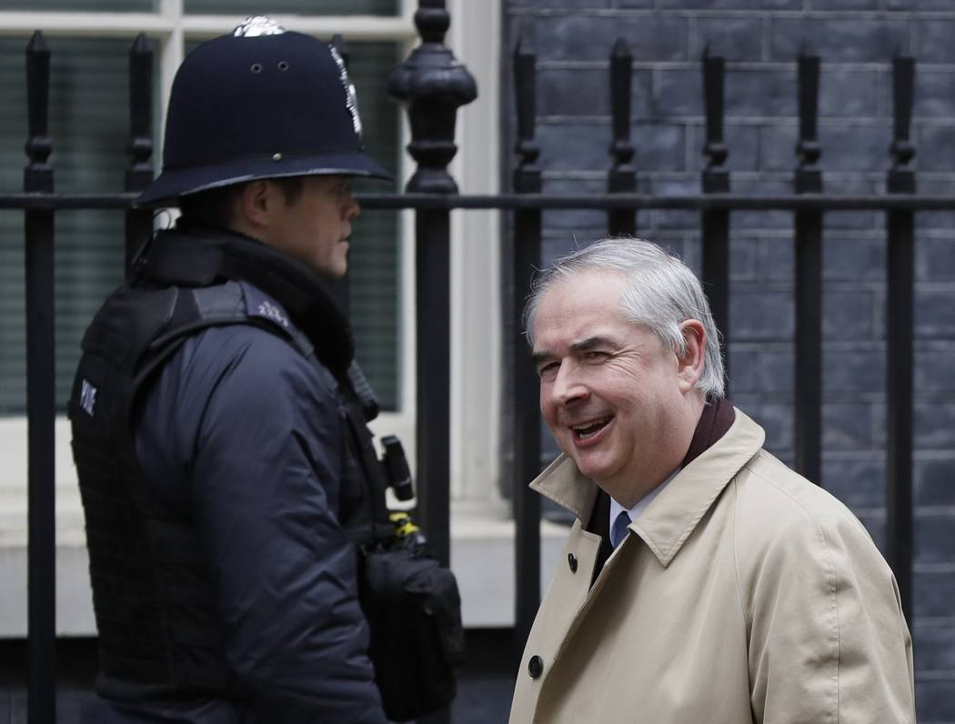 Attorney General Geoffrey Cox arrives for a cabinet meeting at Downing Street in London, Tuesday, March 12, 2019. Prime Minister Theresa May scrambled to win last-minute changes from the European ...