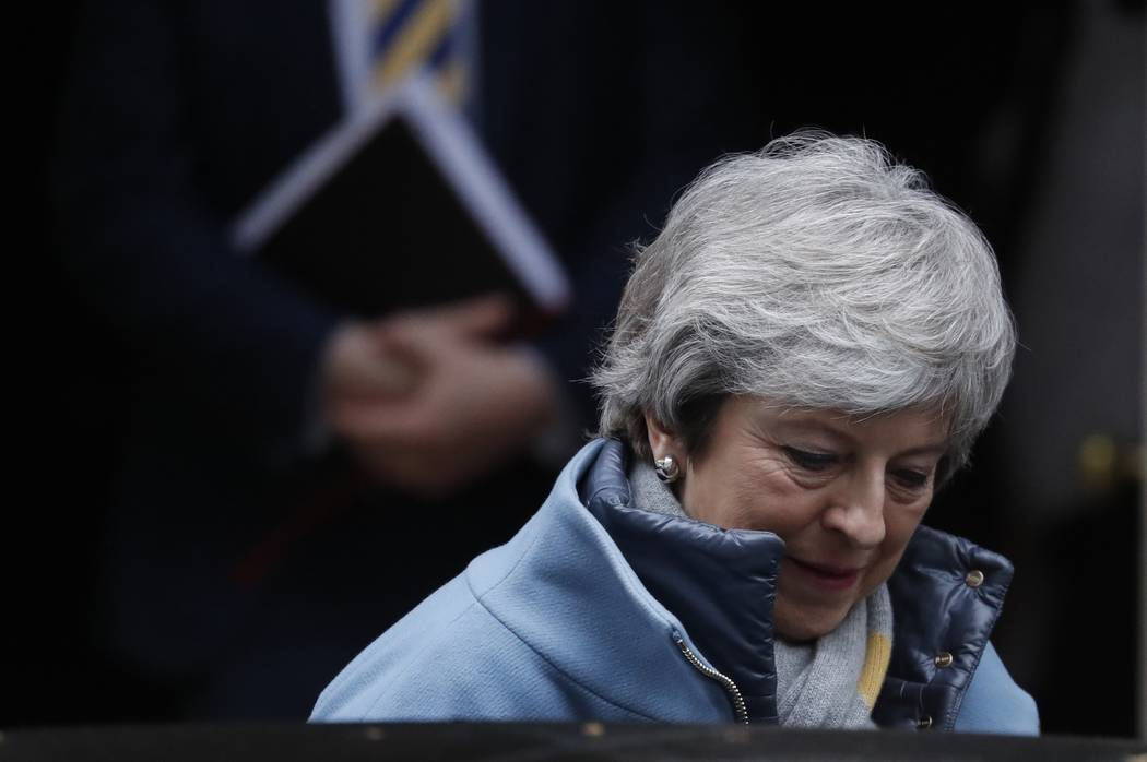 Britain's Prime Minister Theresa May leaves from Downing Street in London, Tuesday, March 12, 2019. Prime Minister Theresa May scrambled to win last-minute changes from the European Union to her B ...