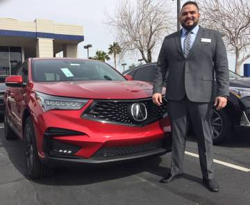 Findlay Acura sales manager Tino Villalobos shows off the newly-designed 2019 RDX SUV at the dealership at 315 Auto Mall Drive. (Findlay)