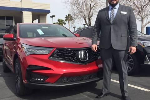 Findlay Acura sales manager Tino Villalobos shows off the newly-designed 2019 RDX SUV at the dealership at 315 Auto Mall Drive. (Findlay)