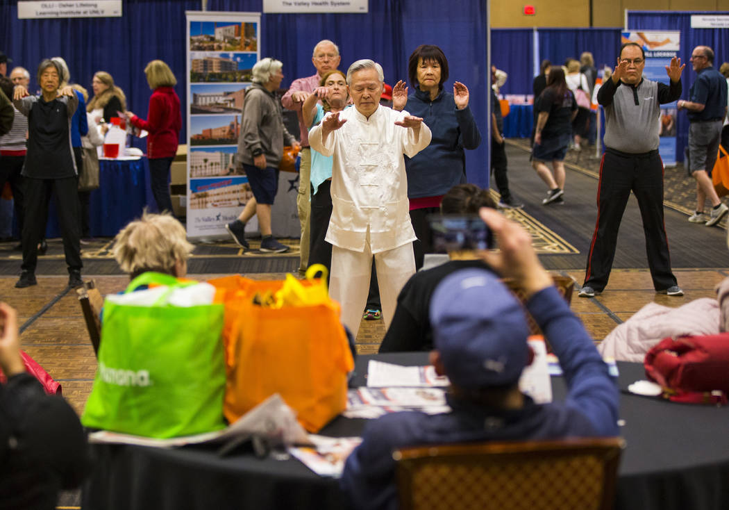 David Ou-Yang leads a beginners session in tai chi and qigong during the fifth annual AgeWell Expo at the Rio Convention Center in Las Vegas on Saturday, March 16, 2019. (Chase Stevens/Las Vegas R ...