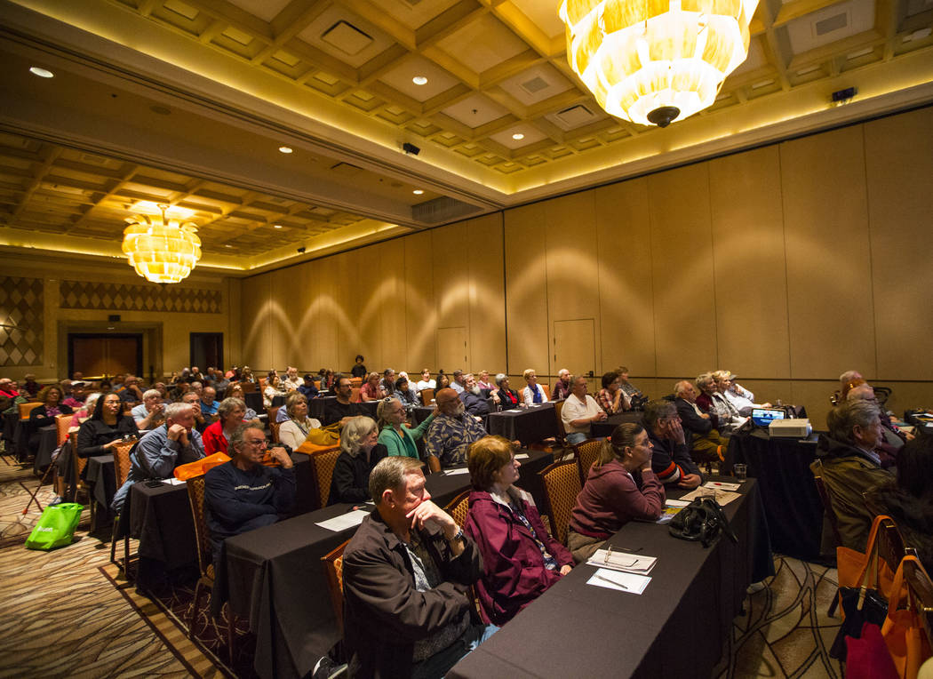 Attendees listen to a presentation by Faith Alchorn-Selk, a sales support representative with Prestige Travel, not pictured, during the fifth annual AgeWell Expo at the Rio Convention Center in La ...