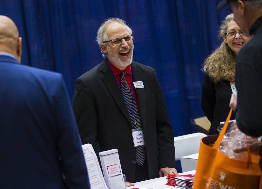 Robert Levrant, director of the Osher Lifelong Learning Institute, or OLLI, at UNLV, talks with attendees during the fifth annual AgeWell Expo at the Rio Convention Center in Las Vegas on Saturday ...