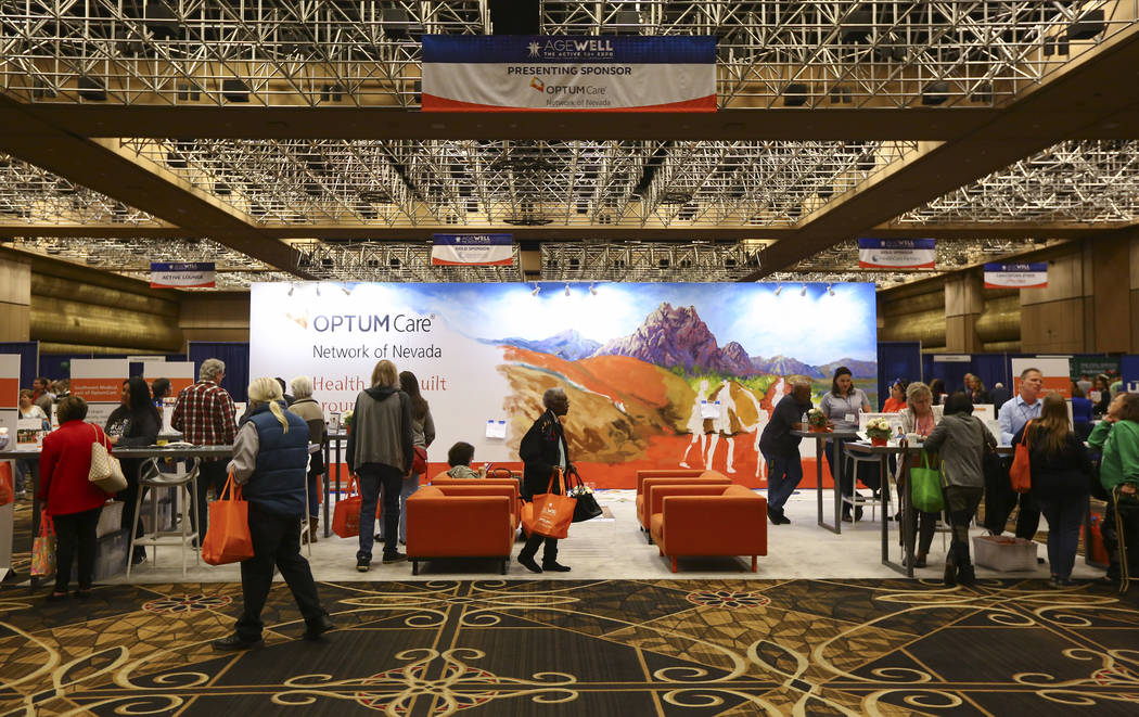 Attendees check out the OptumCare booth during the fifth annual AgeWell Expo at the Rio Convention Center in Las Vegas on Saturday, March 16, 2019. (Chase Stevens/Las Vegas Review-Journal) @csstev ...