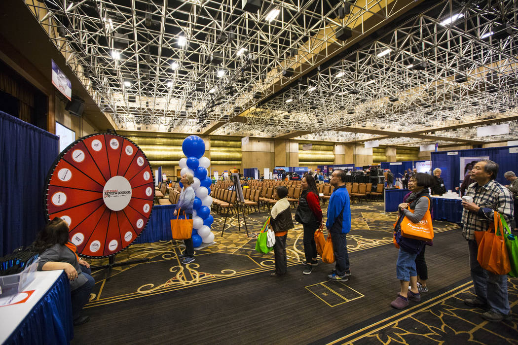 Attendees line up for a Review-Journal promotional giveaway during the fifth annual AgeWell Expo at the Rio Convention Center in Las Vegas on Saturday, March 16, 2019. (Chase Stevens/Las Vegas Rev ...