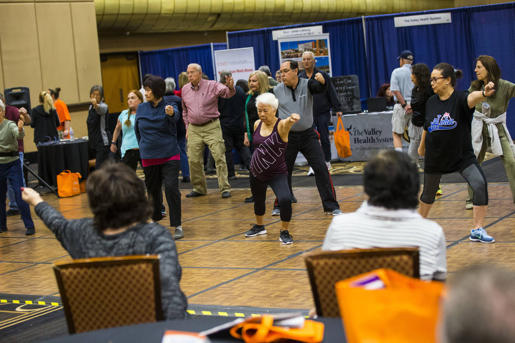 Attendees participate in a tai chi and qigong class during the fifth annual AgeWell Expo at the Rio Convention Center in Las Vegas on Saturday, March 16, 2019. (Chase Stevens/Las Vegas Review-Jour ...