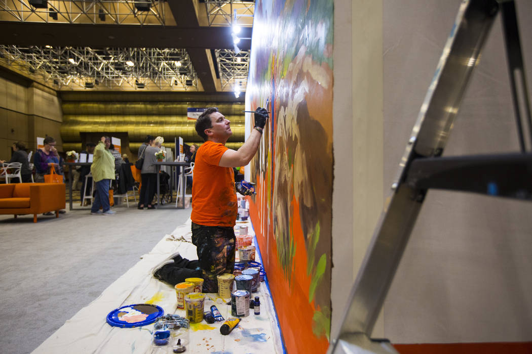 Mural artist Kris Friesen works on a piece at the OptumCare booth during the fifth annual AgeWell Expo at the Rio Convention Center in Las Vegas on Saturday, March 16, 2019. (Chase Stevens/Las Veg ...