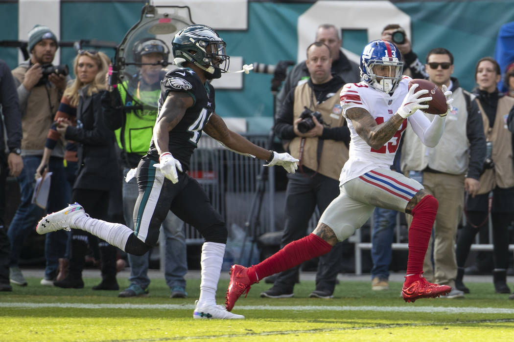 New York Giants wide receiver Odell Beckham Jr. catches the pass with Philadelphia Eagles cornerback DeVante Bausby defending during the first half of the NFL football game, Sunday, Nov. 25, 2018, ...