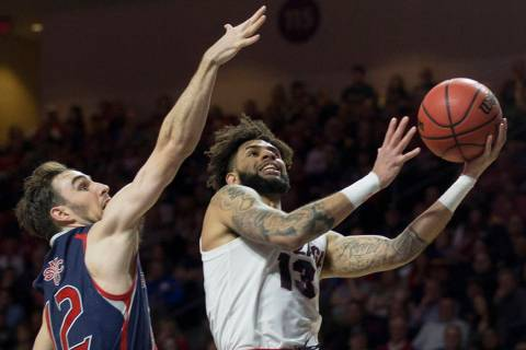 Gonzaga senior guard Josh Perkins (13) slices to the rim past St. Mary's sophomore guard Tommy Kuhse (12) in the first half during the West Coast Conference finals game on Tuesday, March 12, 2019, ...