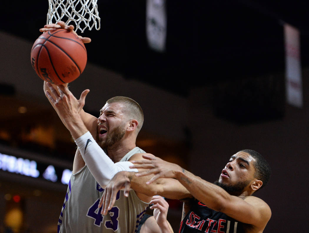 Grand Canyon forward Michael Finke (43) catches a rebound while being guarded by Seattle guard Terrell Brown (23) in the first half of the opening round of the Western Athletic Conference tourname ...