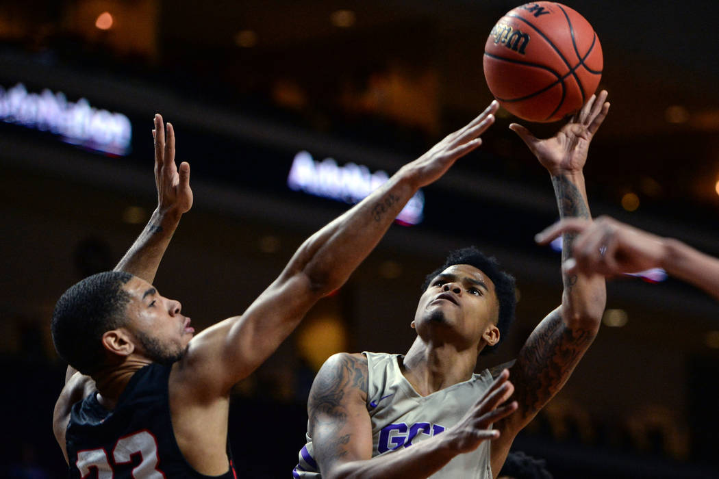 Grand Canyon guard Damari Milstead (11) takes a shot while being guarded by Seattle guard Terrell Brown (23) in the first half of the opening round of the Western Athletic Conference tournament in ...
