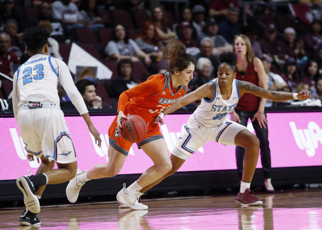 Texas-Rio Grande Valley forward Megan Johnson (34) moves the ball between New Mexico State guard Aaliyah Prince (23) and Gia Pack (30) during a NCAA college basketball Western Athletic Conference ...