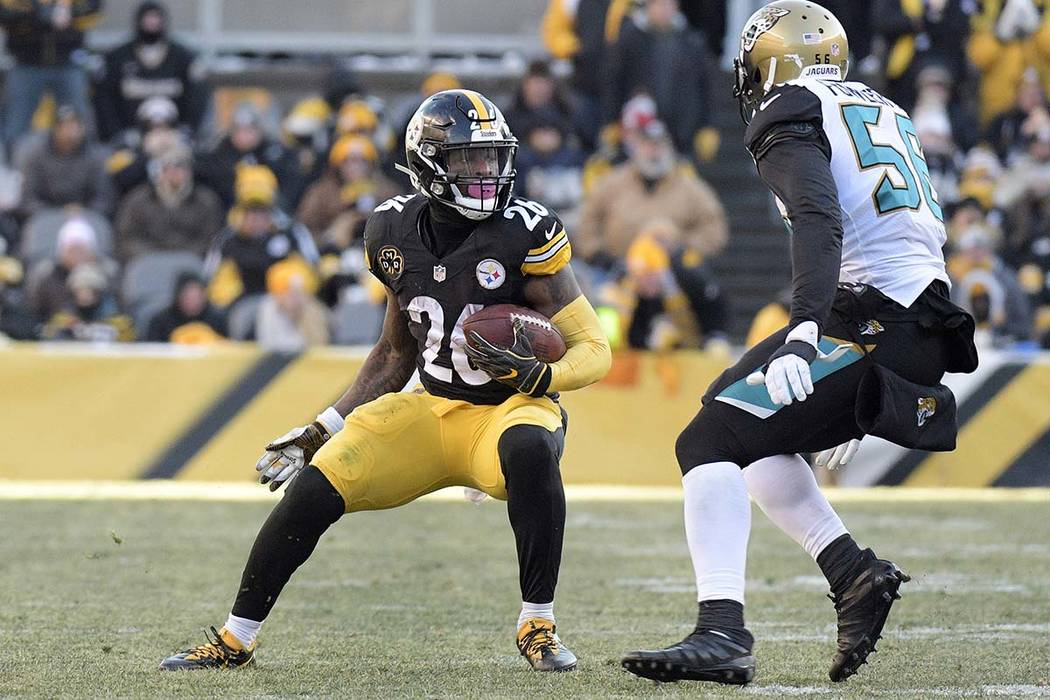 Pittsburgh Steelers running back Le'Veon Bell (26) tries to get past Jacksonville Jaguars defensive end Dante Fowler (56) during the second half of an NFL divisional football AFC playoff game in P ...