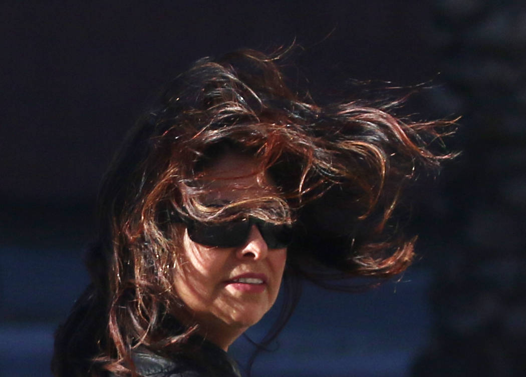 A woman's hair blows across her face as she struggles to walk in strong winds on Casino Center Boulevard on Wednesday, March. 13, 2019, in Las Vegas. Bizuayehu Tesfaye Las Vegas Review-Journal @bi ...