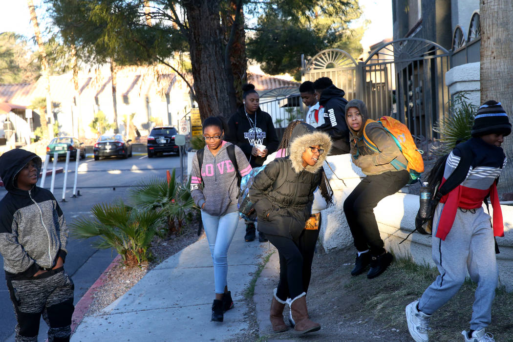 Students brace from the wind and cold while making their way to the school bus at Desert Shores Villas in Las Vegas Wednesday, March 13, 2019. (K.M. Cannon/Las Vegas Review-Journal) @KMCannonPhoto