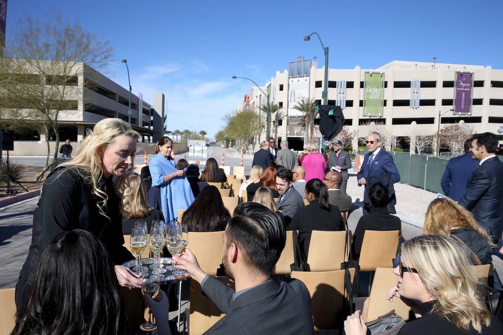 Misty Grimm serves champagne during a unveiling ceremony for Robin Leach Lane running between the Cleveland Clinic Lou Ruvo Center for Brain Health and The Smith Center for the Performing Arts in ...