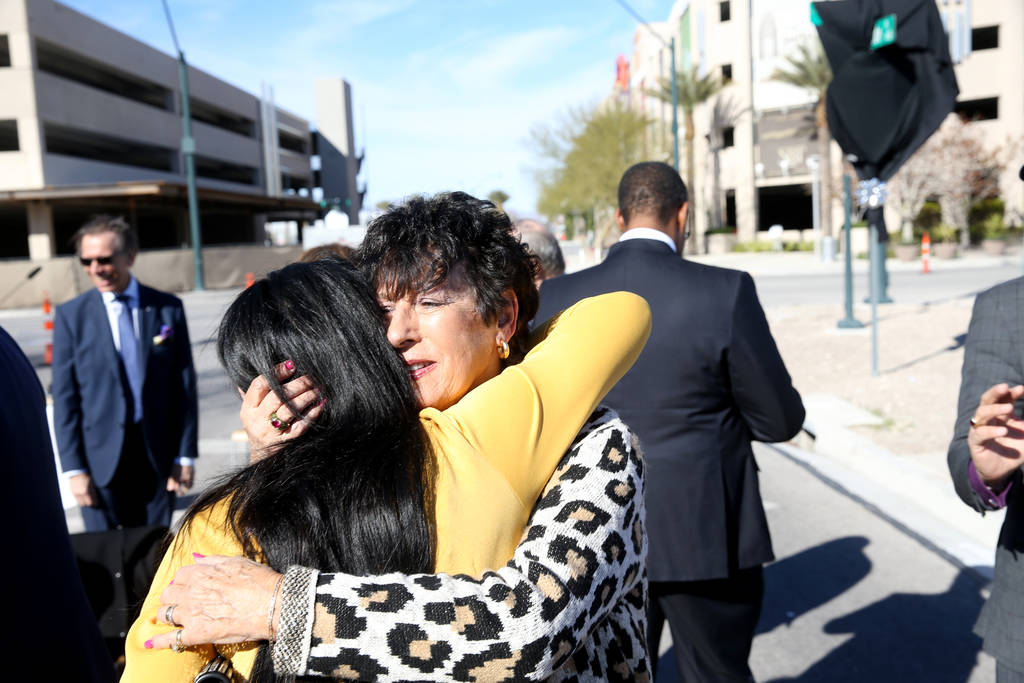 Judy Bryer, right, and Jennifer Romas, both of Las Vegas, hug during a unveiling ceremony for Robin Leach Lane running between the Cleveland Clinic Lou Ruvo Center for Brain Health and The Smith C ...
