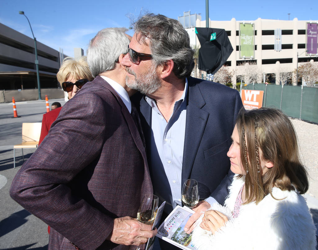 Larry Ruvo, left, visits with the late Robin Leach's son, Steve Leach and his daughter Gianna, 10, during a unveiling ceremony for Robin Leach Lane running between the Cleveland Clinic Lou Ruvo Ce ...