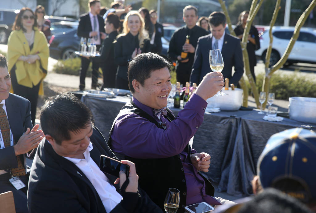 Don Chareunsy, long time friend and colleague of the late Robin Leach, toasts the crowd after they sang happy birthday to him during a unveiling ceremony for Robin Leach Lane running between the C ...