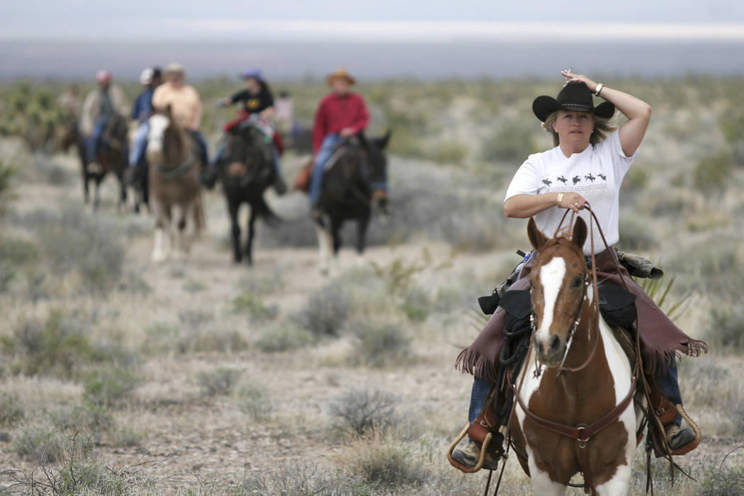 """Kelley Bullock, right, rides """"Little Gizz"""" into camp for lunch during the Las Vegas Review-Journal trail ride Friday, April 21, 2006. Some 35 riders along with guides will finish their two-day rid ..."""
