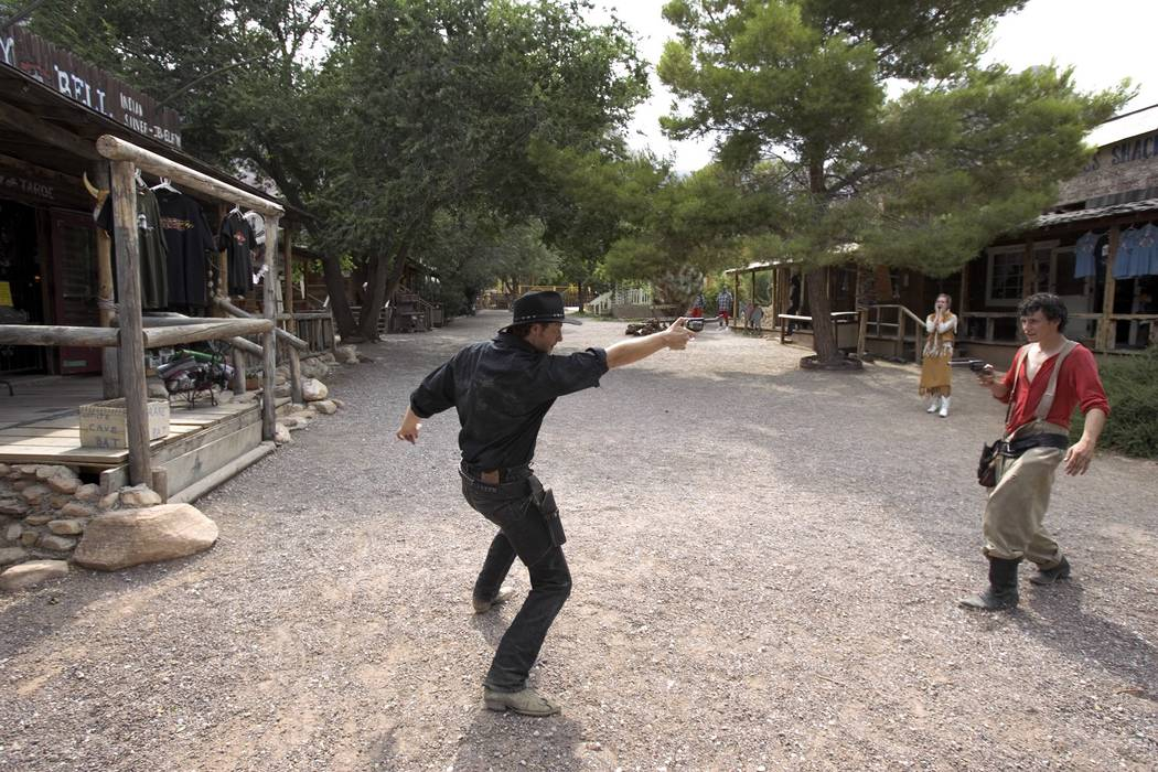 """Gunfighters Presley """"Last Chance Vance"""" Conkle, left, and Kendall """"Hollywood Cowboy"""" Zobrist put on a show a Bonnie Springs Old Nevada old West town theme park in Red Rock Canyon, July 20, 2005. O ..."""