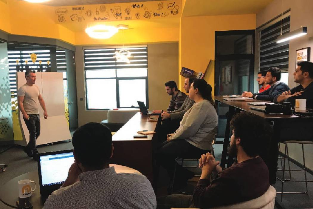 John Unal talks about business plan training to early stage startups at a co-working space in Istanbul in December 2018. (courtesy)