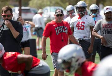 UNLV football coach Tony Sanchez watches over his players as they runs through drills during team practice at UNLV's Rebel Park in Las Vegas on Monday, Aug. 20, 2018. Richard Brian Las Vegas Revie ...