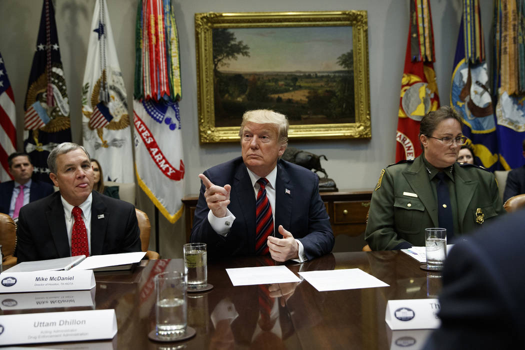 President Donald Trump calls on a reporter during a briefing on drug trafficking at the southern border in the Roosevelt Room of the White House, Wednesday, March 13, 2019, in Washington. (AP Phot ...