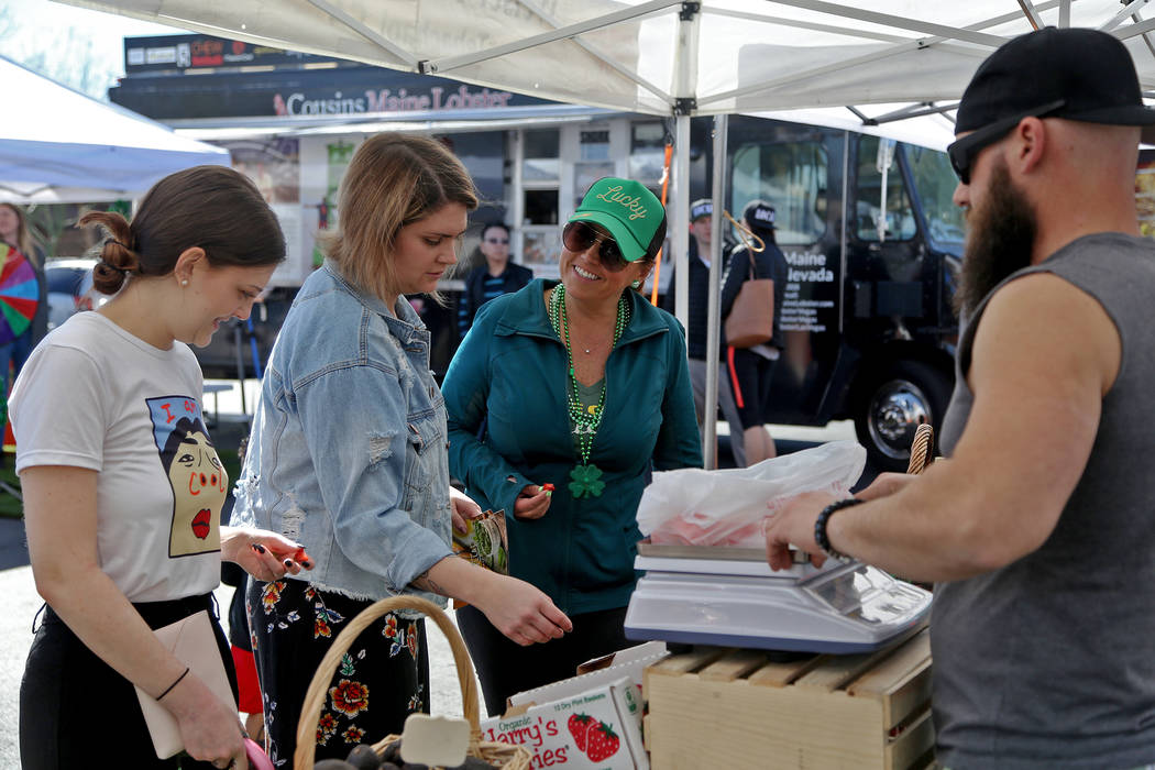 Carrie Hogan, founder of the Fresh52 farmers and artisans market, center, speaks to Jessica Dodd at the Fresh52 farmers and artisans market in Las Vegas, Sunday, March 17, 2019. (Rachel Aston/Las ...
