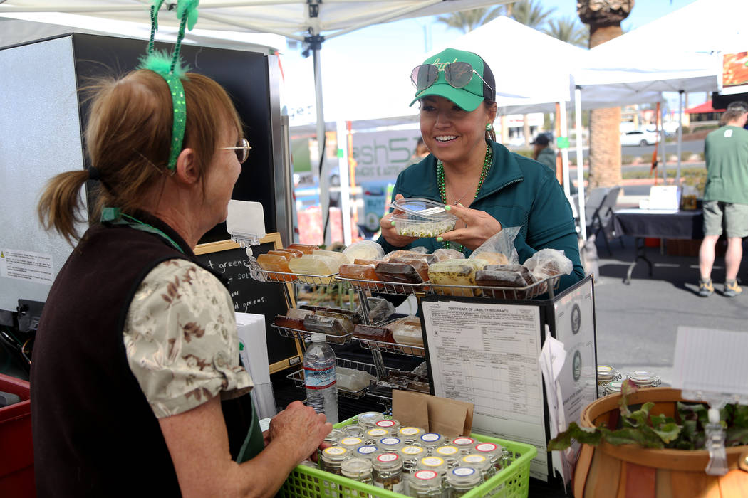 Carrie Hogan, founder of the Fresh52 farmers and artisans market, speaks to vendor Diane Greene at her booth Herbs by Diane at the Fresh52 farmers and artisans market in Las Vegas, Sunday, March 1 ...