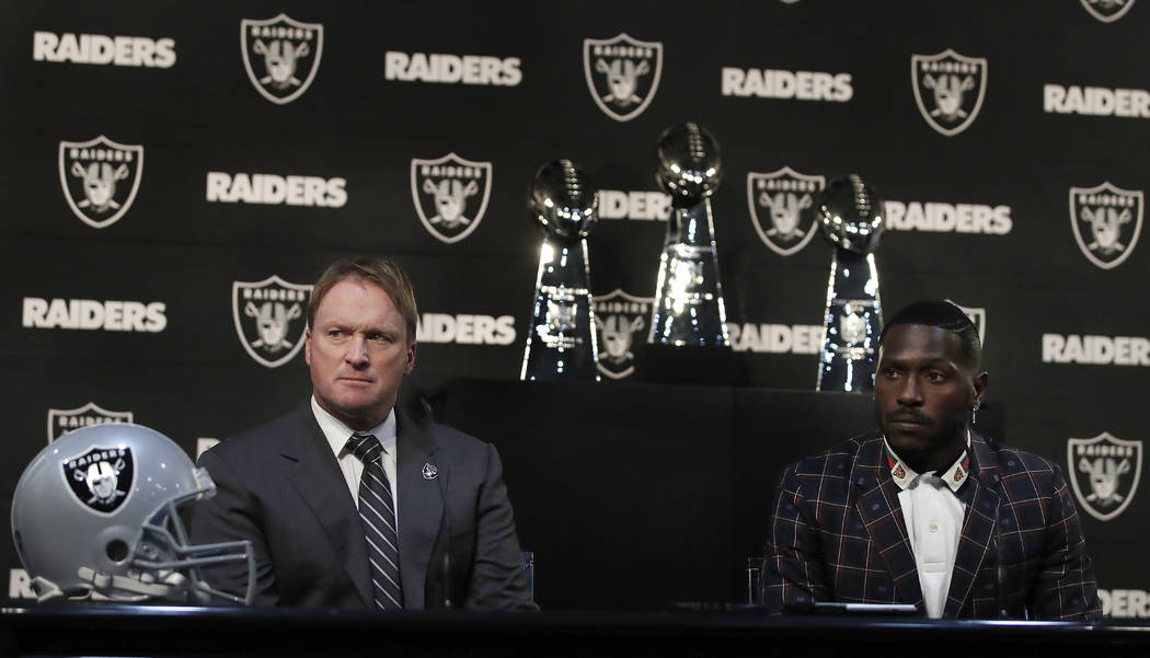 Oakland Raiders coach Jon Gruden, left, and wide receiver Antonio Brown listen to questions from the media during an NFL news conference, Wednesday, March 13, 2019, in Alameda, Calif. (AP Photo/Be ...