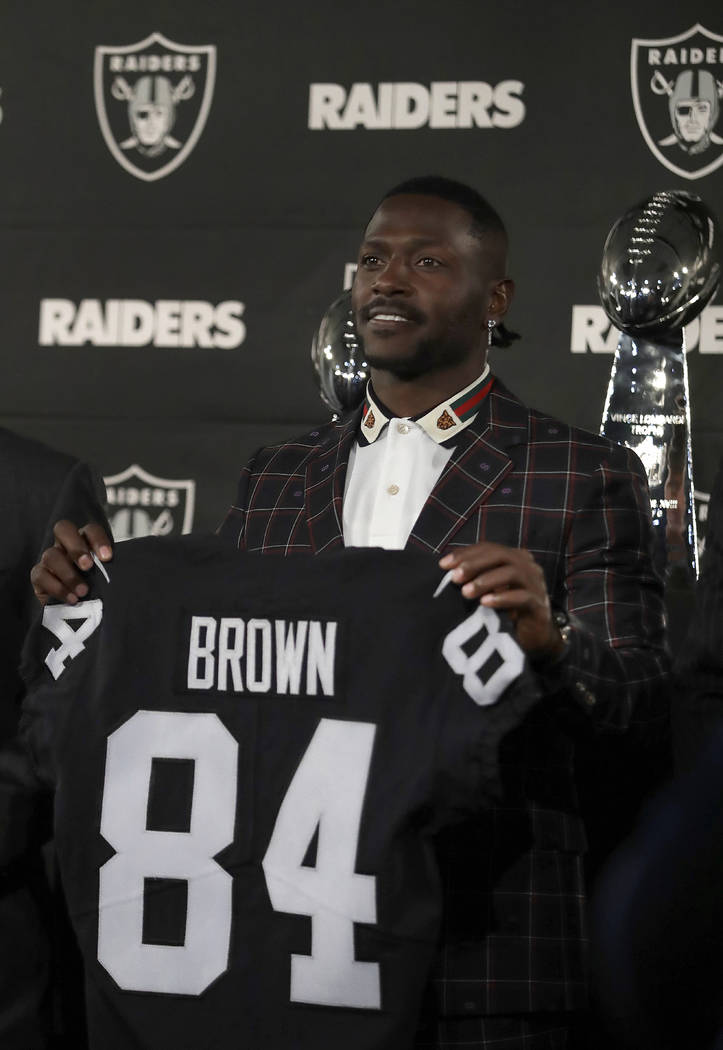 Oakland Raiders wide receiver Antonio Brown holds his jersey during an NFL football news conference, Wednesday, March 13, 2019, in Alameda, Calif. (AP Photo/Ben Margot)