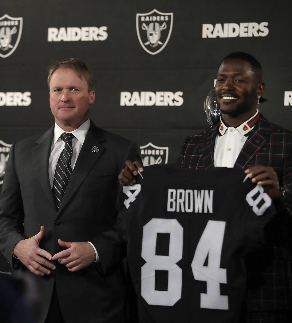 Oakland Raiders wide receiver Antonio Brown, right, holds his jersey beside coach Jon Gruden during an NFL football news conference, Wednesday, March 13, 2019, in Alameda, Calif. (AP Photo/Ben Margot)
