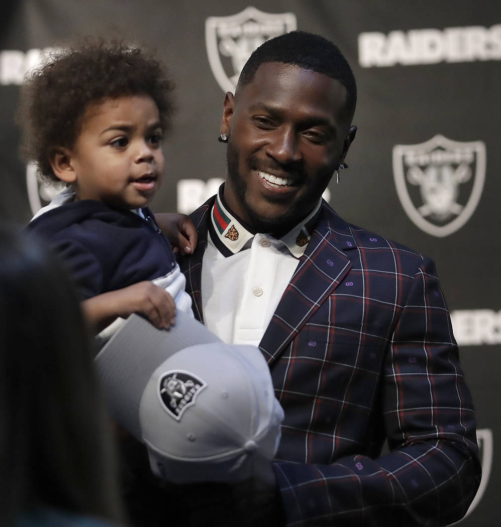 Oakland Raiders wide receiver Antonio Brown holds his son Apollo prior to an NFL football news conference, Wednesday, March 13, 2019, in Alameda, Calif. (AP Photo/Ben Margot)