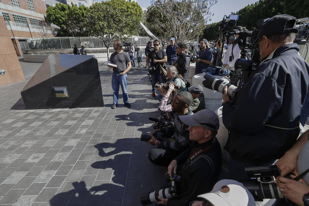 Members of the media wait outside the federal courthouse for actress Lori Loughlin Wednesday, March 13, 2019, in Los Angeles. Fifty people, including actress Loughlin, were charged Tuesday in a sc ...